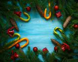 Christmas border with fir tree branches, cones, christmas decorations and can Stock Photos