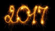 Happy New Year - 2017 with sparklers on black Stock Photos