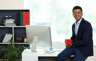 Handsome young man working from home office Stock Photos