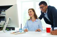 Beautiful young woman and man working from home Stock Photos