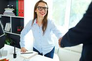 Modern  business woman with arm extended to handshake Stock Photos