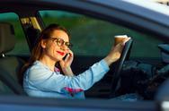 Businesswoman multitasking while driving Stock Photos