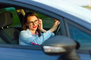 Businesswoman multitasking while driving Stock Photos