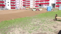 Details of playground, sand near building under construction site Stock Footage