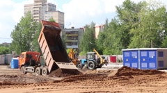 Truck and tractors work on construction site Stock Footage
