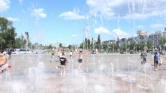 Youth have fun in dry fountain Stock Footage