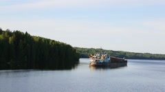 Cargo ship with a cargo of timber on the Svir River Stock Footage