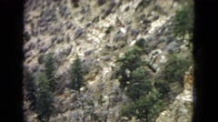 1967: a beautiful rugged mountain and canyon landscape under a cloudy sky Stock Footage