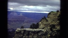 1967: stone cliffs viewed from above on a cloudy day ARIZONA Stock Footage