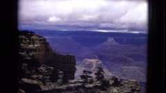 1967: a beautiful view of a massive canyon under a cloudy sky ARIZONA Stock Footage