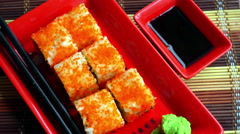 Delicious japanese roll on a red plate Stock Footage