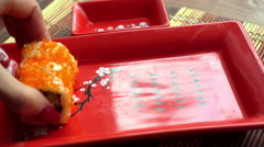 Delicious japanese rolls on red plate Stock Footage