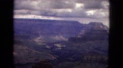 1967: a beautiful view of the rugged grand canyon under a dark, cloudy sky Stock Footage