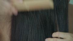 Woman combs her long hair, closeup Stock Footage