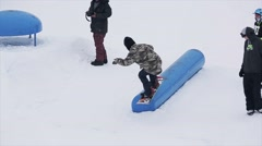 Snowboarder jump on kicker at ski resort in mountains. Extreme hobby. People Stock Footage