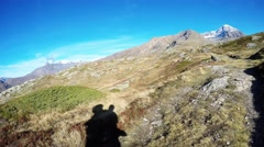 Backpacker hiking on the Alps, autumn season. Subjective view. Stock Footage