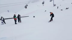 Snowboarder ride on iron trail at slope. Ski resort in snowy mountains Stock Footage