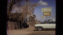 1967: man walking in front of old restaurant and car. women entering phone Stock Footage