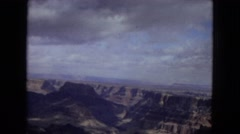1967: view of a rocky canyon showing a mountain plateau in the distant horizon Stock Footage
