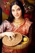 Beauty sweet real indian girl in sari smiling on black background Kuvituskuvat