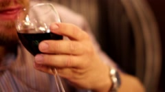 Man tasting red wine Stock Footage