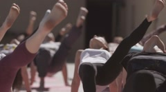 Young people do yoga at open playground in sunny morning, stretching. Fresh air Stock Footage