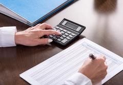 Woman doing her accounting Stock Photos