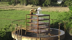 Tank water filter system in countryside. Stock Footage