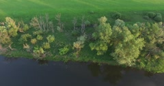 Flying over the field and the river Stock Footage