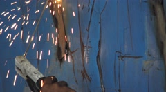 Welder  welding metal by electrode with bright electric arc and sparks. Stock Footage