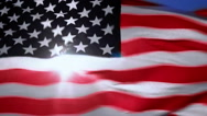 Sunlight through American flag Stock Footage