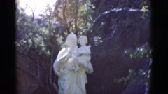 1966: white marble statue of a woman carrying a baby in her arms CLARKSDALE Stock Footage