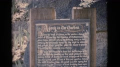 1966: a sign carved in stone referring to a garden entrance with words Stock Footage