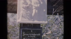 1966: statue holy outdoor inscription writing religious view CLARKSDALE, ARIZONA Stock Footage