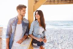 Young cheerful couple flirting at the beach Stock Photos