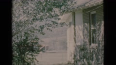 1966: view of a house with roses and lattices windows and the neighboring house Stock Footage