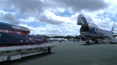 Bloodhound Supersonic Car and Boeing 747 -8F Stock Footage