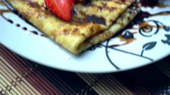 Beautiful freshly cooked chocolate pancakes Stock Footage