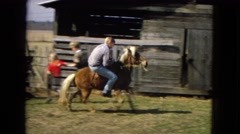 1967: a young adult riding a pony difficulty in a rural area ARIZONA Stock Footage