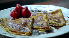 Freshly cooked chocolate pancakes with sugar powder Stock Footage
