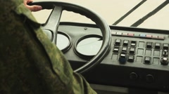 The military man is sitting in the cockpit of car driving Stock Footage