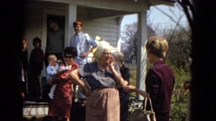 1967: a family gathered outdoor on the porch and lawn ARIZONA Stock Footage