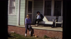 1967: two women sitting out on the front porch of a house ARIZONA Stock Footage