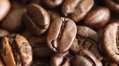 Rotating roasted coffee beans background concept Stock Footage