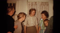 1967: a family gathered with a soldier in the livingroom ARIZONA Stock Footage