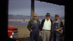 1967: four men standing outdoor by a truck near a body of water ARIZONA Stock Footage