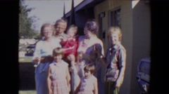 1967: multiple generations posing in a bright sunny driveway TUCSON, ARIZONA Stock Footage
