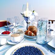Breakfast with croissants, bilberry pie and beverages. Stock Illustration