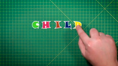 Man puts letters the word child care Stock Footage