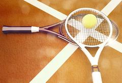Tennis rackets and ball are located on ground court. Stock Illustration
